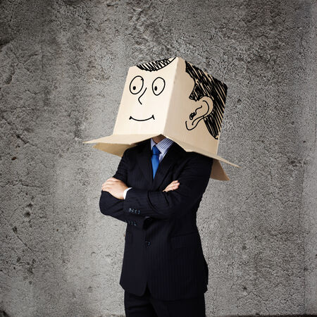 masquerader: Businessman wearing carton box with smileys on head