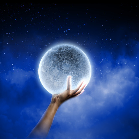 Close of man hands holding moon planet photo