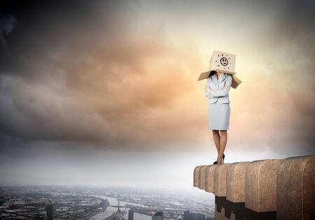 boxy: Businesswoman in suit wearing carton box on head