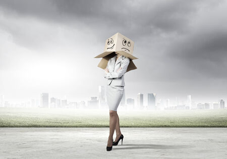 woeful: Businesswoman in suit wearing carton box on head