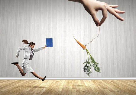 chased: Funny image of businesswoman chased with carrot