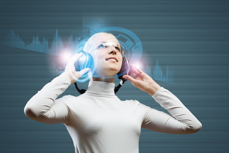 Young woman in white against media background wearing headphones photo
