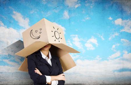 cowardice: Funny businesswoman with carton box on head