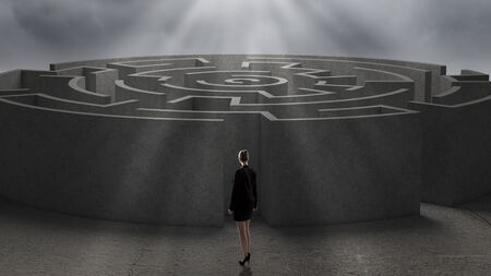 Businesswoman standing near the enter of labyrinth photo