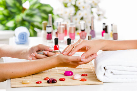 french manicure: Close up of process of manicure at beauty salon