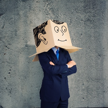 Businessman wearing carton box with smileys on head