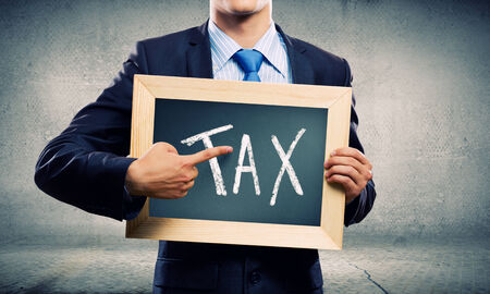 tax tips: Close up of businessman holding frame with business sketches