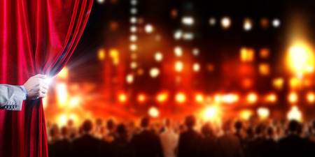 stage curtain: Hand of businessman opening red velvet curtain