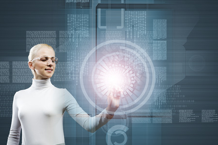 Woman in white touching icon of media screen photo