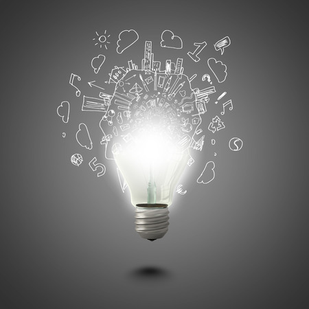 Conceptual image of electric bulb against grey background
