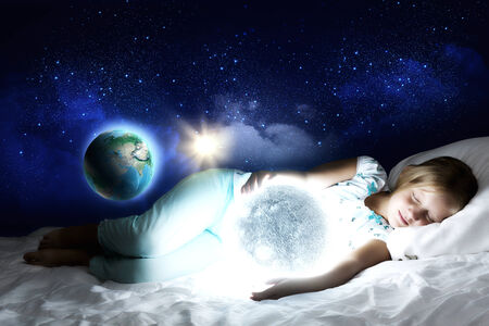 Girl lying in bed with moon in hands  Elements of this image are furnished by NASA photo