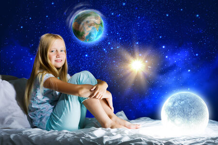 Girl sitting in bed and dreaming  Elements of this image are furnished by NASA photo
