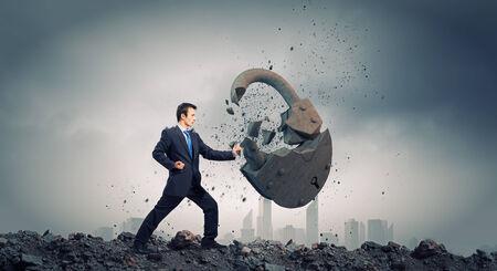 karate kick: Businessman breaking stone lock with karate kick