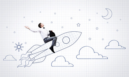 Young businessman,an flying in sky on drawn rocket photo