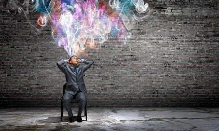 new thinking: Young businessman thinking over the ideas  Creativity concept