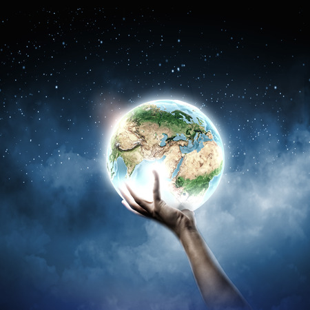 save the earth: Close up of human hand holding Earth planet