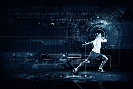 Young running man against digital media background Imagens