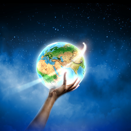 Close up of human hand holding Earth planet. photo