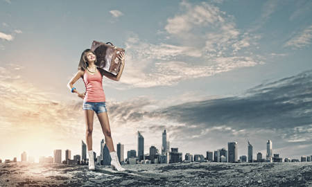 Young pretty woman tourist walking with suitcase photo