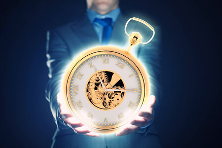 dealerships: Young businessman holding pocket watch in hand