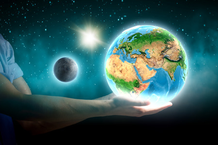Close up of human hand holding Earth planet  photo