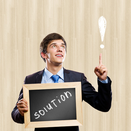 Business ideas wrote on desk in hands photo