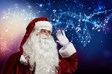 Santa Claus enjoying the sound of music photo