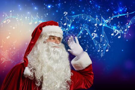 Santa Claus enjoying the sound of music photo