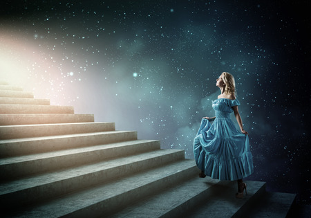 heavens gates: Young blond woman in blue dress walking up the stairs