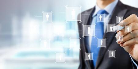 Close up of businessman drawing social net symbols photo