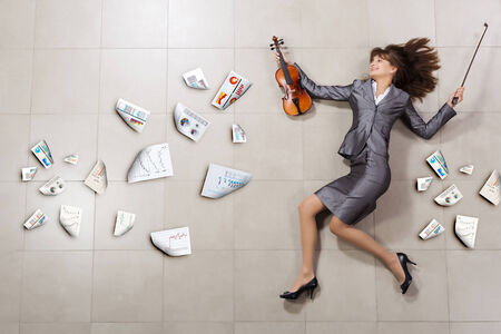 Funny image of running businesswoman with violin in hand