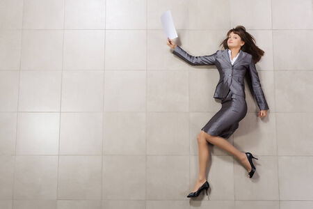 Funny image of businesswoman running with documents in hand photo