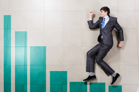 Businessman running on increasing graph  Growth concept photo