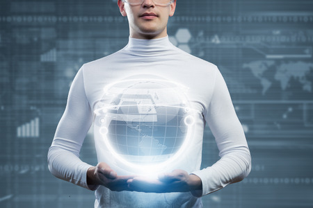 Man holding globe in hands  Futuristic concept photo
