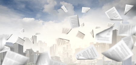 background image with papers flying in air Stock Photo