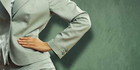 Close up of confident businesswoman with hand on waist Stock Photo