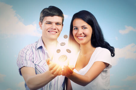 cent: Young happy couple holding cent in palms