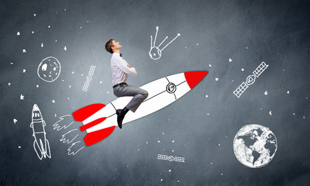 rocket man: Young businessman,an flying in sky on drawn rocket Stock Photo
