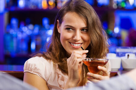 couple talking: Young couple in bar having drinks and talking Stock Photo