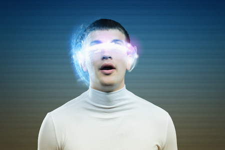 Young man in white against blue background with hologram around head photo