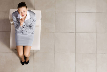 Top view of thoughtful businesswoman sitting on chair photo