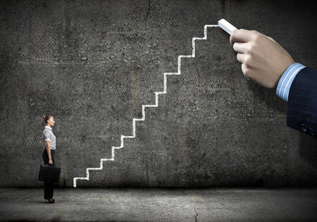 Businesswoman stepping ladder drawn by hand with chalk Stock Photo