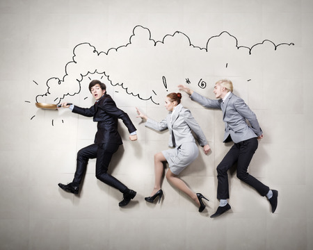 Young people in business suits lying on floor photo
