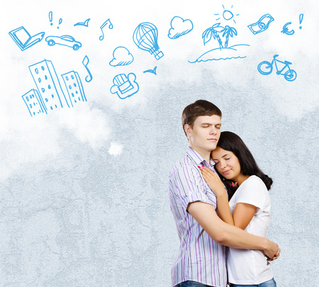 Young couple hugging each other and dreaming about future photo