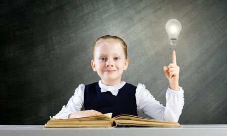 schoolkid search: Schoolgirl at lesson with opened book against sketch background
