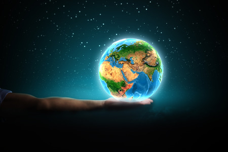 Close up of human hand holding Earth planet  Elements of this image are furnished by NASA photo