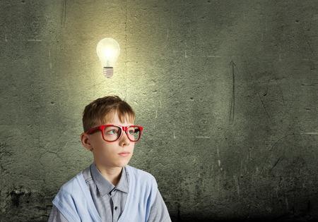 discover: Boy of school age in glasses  Idea concept