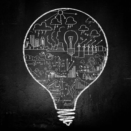 Conceptual image of light bulb on black wall photo