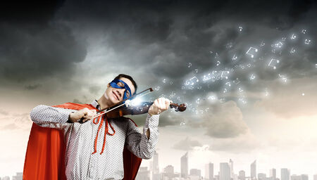 speed of sound: Young man in superhero costume playing violin