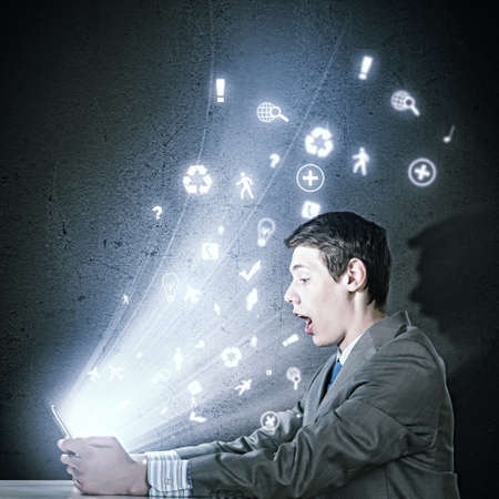 stress testing: Young businessman looking surprised into tablet pc  Net and communication